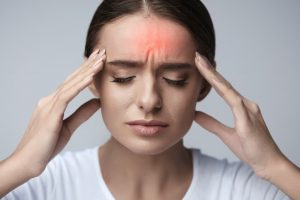 Woman experiencing a bad case of migraine