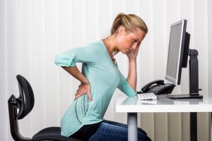 Woman experiencing backpain from sitting
