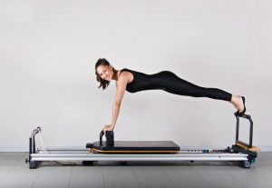 Woman using clinical pilates