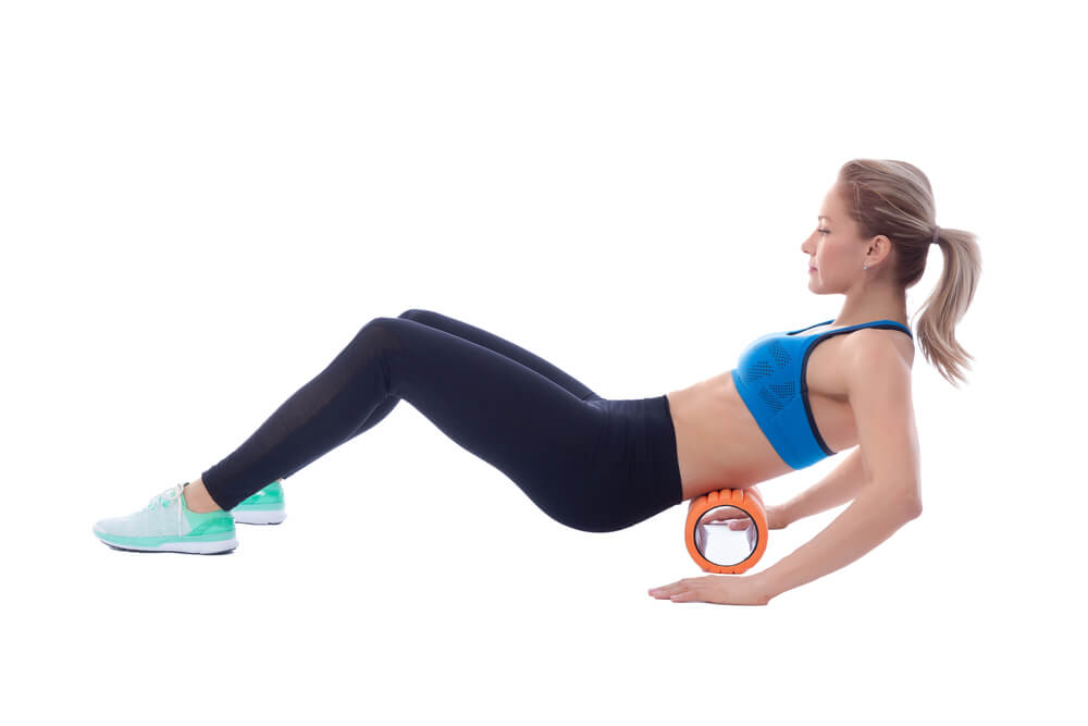 Woman exercising using her foam roller
