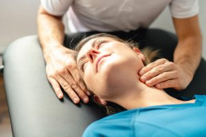 A beautiful woman having a neck physiotherapy