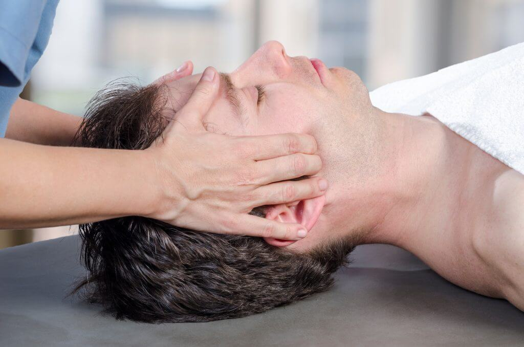 Man being treated for his jaw pain