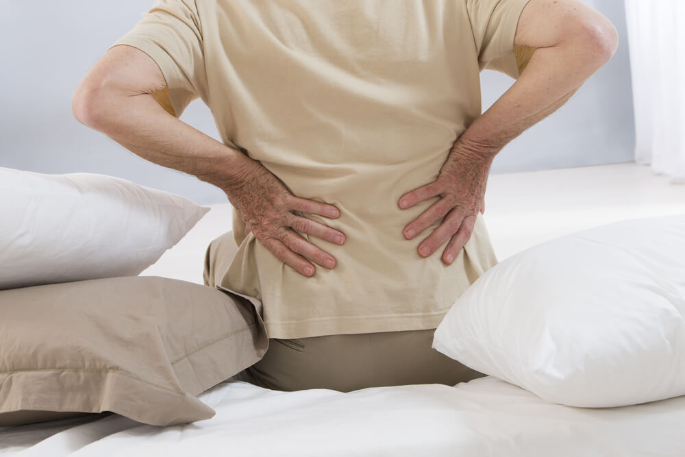 Man experiencing a backpain