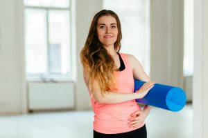Woman carrying a foam roller