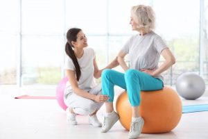Physiotherapist and old woman talking
