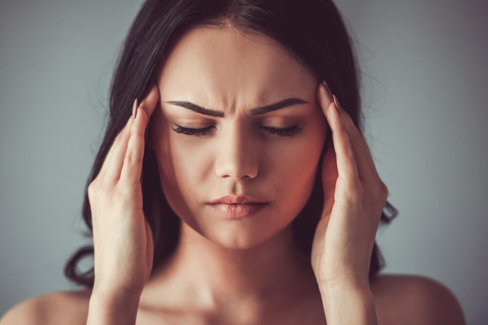 Woman experiencing a headache