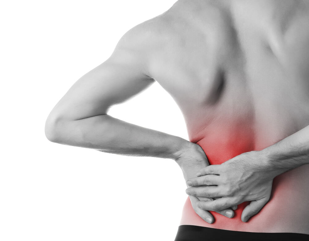 Man suffering from a lower back pain with illustration